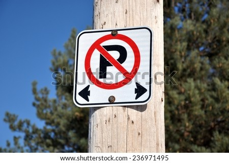 No parking on both sides sign - stock photo