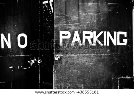 no parking sign on metal gate