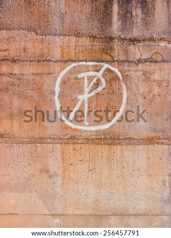 no parking sign painted on a  wall - stock photo