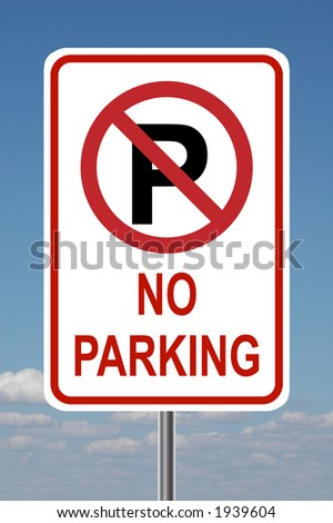 No parking traffic sign with clouds in the background - stock photo