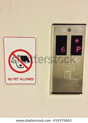 no pet allow sign next to elevator  - stock photo