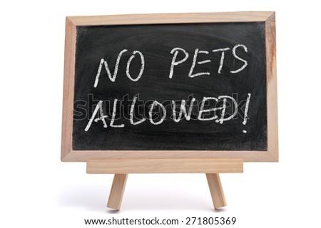 No pets allowed words written on blackboard using chalk - stock photo