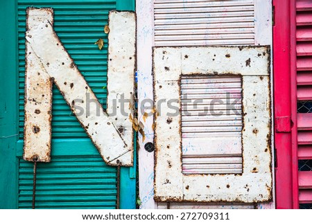 No sign made by rusty metal on old door background - stock photo