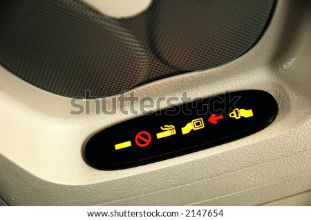No Smoking and Fasten Seatbelt Sign Inside an Airplane - stock photo