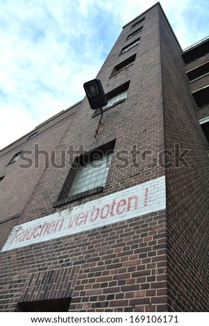 No smoking in an abandoned factory - stock photo