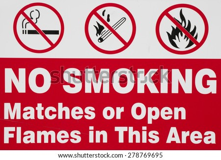 No smoking, matches or open flames warning sign. - stock photo