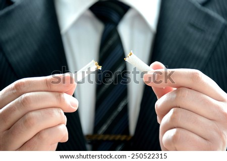 No smoking message by businessman - stock photo