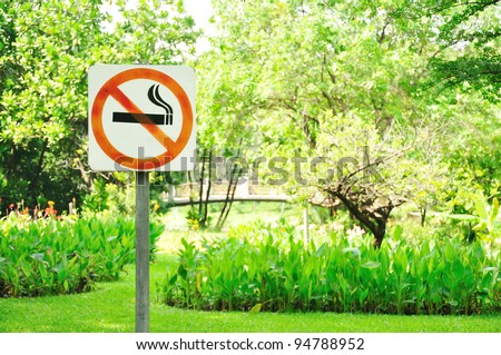 no smoking metal sign in the park - stock photo