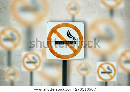 no smoking metal sign on abstract cement background. - stock photo