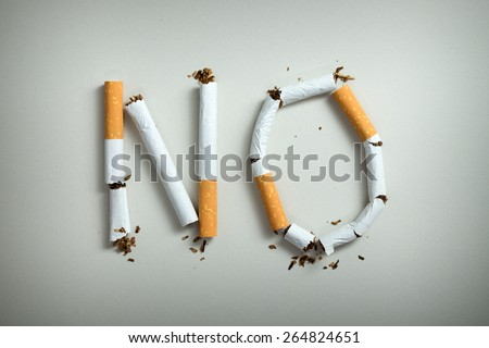 No smoking sign made with broken cigarettes - stock photo