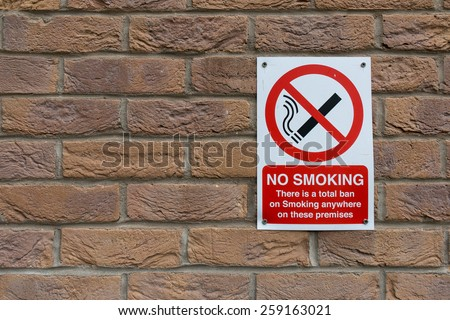 No Smoking Sign on Orange Brick Wall - stock photo