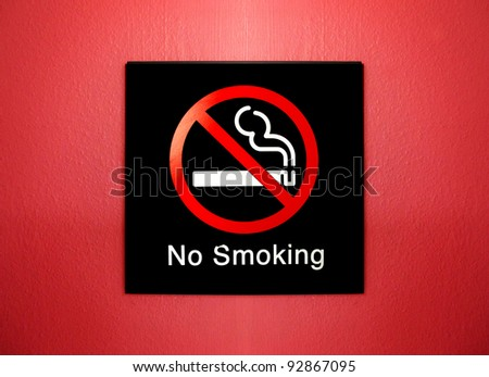 no smoking sign on red grunge wall