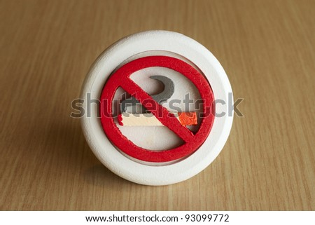 No Smoking Sign on wood table in restaurant with text space - stock photo
