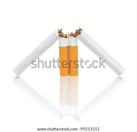 No smoking. Two broken cigarette on a white background with a reflection of close-ups.