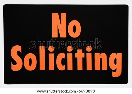 No soliciting sign with orange text against black. - stock photo