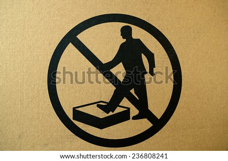 No stepping on surface warning sign, cardboard surface - stock photo