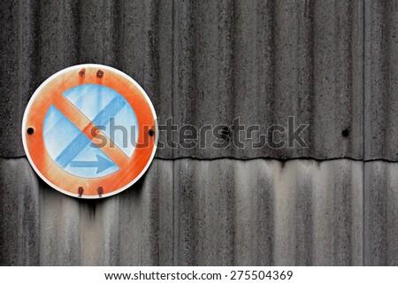 No stopping sign on asbestos wall - stock photo