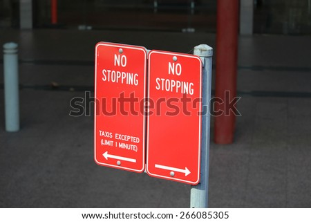 No Stopping Taxis Excepted Limit 1 Minute  traffic sign with arrows in Sydney Australia - stock photo