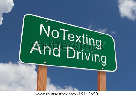 No Texting and Driving Sign, Green highway sign with words No Texting and Driving with blue sky background - stock photo