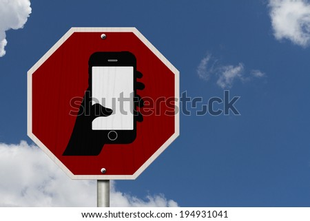No Texting and Driving Sign, Red Stop sign with symbol of a hand and texting isolated with a blue sky background - stock photo