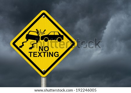 No Texting While Driving Sign, Yellow warning sign with words No Texting and accident icon with stormy sky background - stock photo