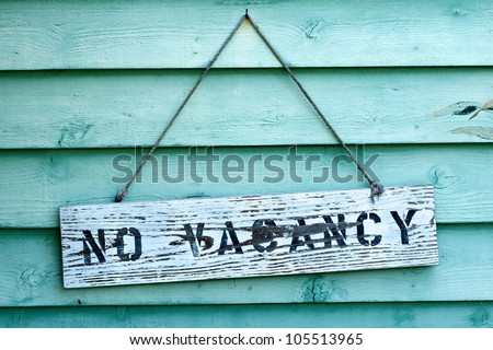 No vacancy sign hanging from rental property in Florida. - stock photo