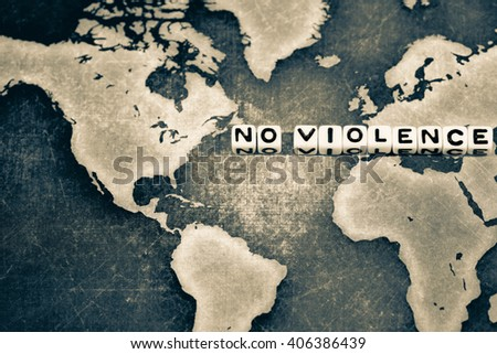 NO VIOLENCE on grunge world map, black and white