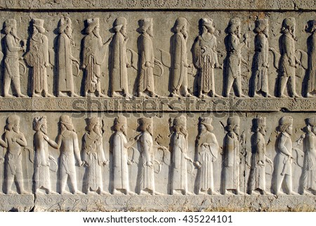 Noblemen relief detail on the stairway facade of the Apadana at the old city Persepolis. Shiraz, Iran - stock photo