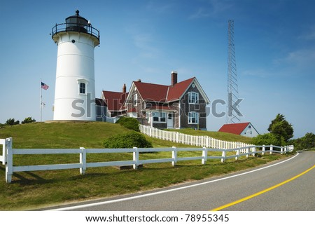 """Nobska (""""Nobsque"""") Light is located at the southwestern tip of Cape Cod, between Buzzard's Bay and Vineyard Sound. The first lighthouse on the site was built in 1828. - stock photo"""