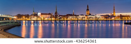 Nocturnal panoramic view on old city of Riga from embankment of the left bank of Daugava river. In 2014, Riga was the European capital of culture and famous city of medieval architecture  - stock photo