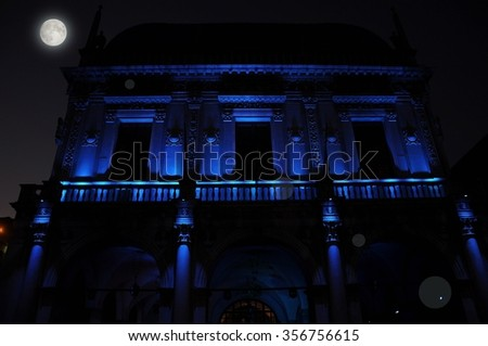 Nocturnal renaissance architecture in blue light. Piazza Loggia. Today seat of the city council (City Hall) of the city of Brescia, Italy.