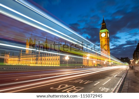 Nocturne scene with Big Ben and House of Parliament behind light beams - London - UK - stock photo