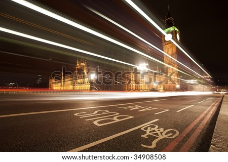 Nocturne scene with Big Beng behind light beams - stock photo