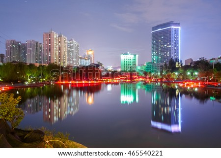 Nocturne view of the lake in the Yantan Park in Lanzhou (China)