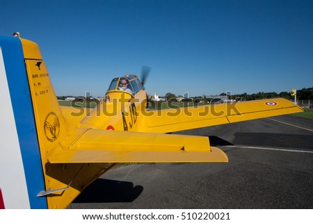 NOGARO, FRANCE - OCTOBER 9: an old yellow airplane is ready to take off to at Classic Festival, on October 9, 2016, in Nogaro, France.
