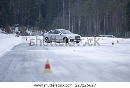 NOKIA, FINLAND - February 11, 2014: The Audi Quattro Tour 2014 test drive day in Nokia, Finland. Professional drivers were teaching how to drive safely in winter conditions on February 11, 2014. - stock photo
