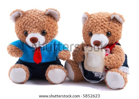 Non-branded toy bears (Boy and Girl, mommy & daddy), with blank message card. Useful for Valentine's Day, or special couple occasions. - stock photo