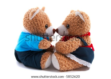 Non-branded toy bears dress up as a couple, with shirt and dress. Facing each other, loving, friendship, communicating, kissing. Useful for Valentine's Day, or special couple occasions. - stock photo