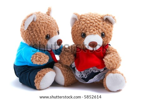 Non-branded toy bears dress up as a couple, with shirt and tie and frilly dress. Boy teddy looking at girl teddy. Useful for Valentine's Day, or special couple occasions. - stock photo