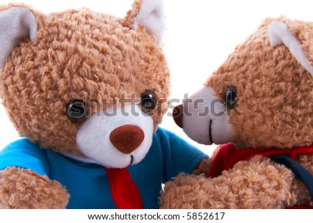 Non-branded toy bears dressed as a couple, with shirt, dress. Facing each other, in love, friendship, communicating, closeup. Useful for Valentine's Day, or special couple occasions. - stock photo