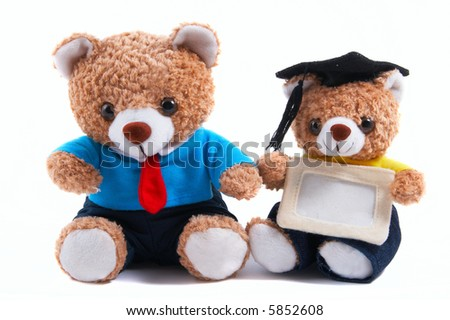 Non-branded toy (father & son) bears in shirt and tie. Business, office attire. Smaller bear with graduate hat and blank card. School / graduation, father-son related use. - stock photo