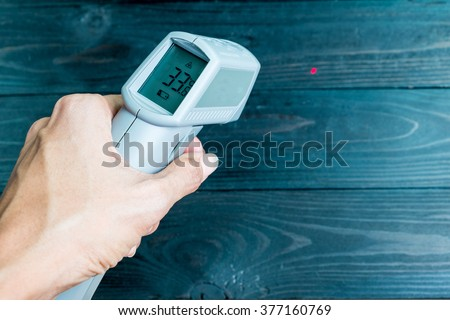 non-contact IR thermometer for check the temperature of wooden floor