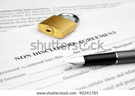 Non disclosure agreement with lock and pen - stock photo