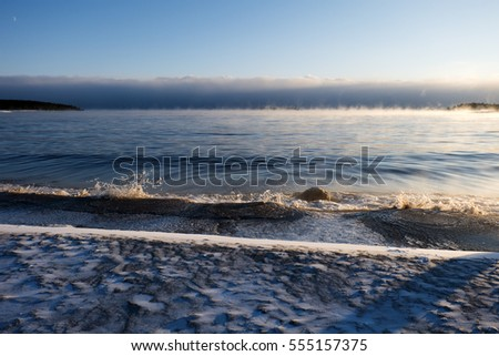 Non-freezing abnormally warm water in extremely cold in Lake Ladoga, January, Karelia, Russia. It is the largest lake in Europe, and the 15th largest freshwater lake by area in the world.