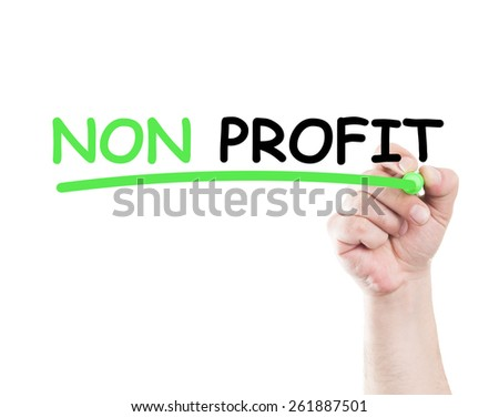 Non profit concept made by a human hand holding a marker on transparent wipe board - stock photo
