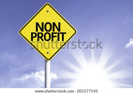 Non Profit road sign with sun background  - stock photo