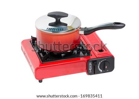 Non-Stick Pot on Portable Gas Stove Isolated on White. - stock photo