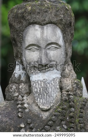 NONG KHAI, THAILAND - AUGUST 8: A large concrete statue in the Buddha Park created by Luang Pu Bunleua Sulilat in the border town of Nong Khai, Thailand on the 8th August, 2014.