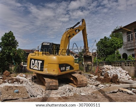 NONG KHAI, THAILAND - August 17, 2015: Tracked Excavator pull down the building to build a new house on August 17, 2015 at Mueang Nong Khai Municipality, Thailand - stock photo