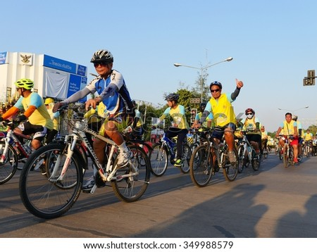 NONG KHAI, THAILAND - December 11, 2015: People ride bicycles in Bike For Dad event, purpose is to grateful to father and respect to the King of Thailand on December 11, 2015 in Nong Khai, Thailand - stock photo